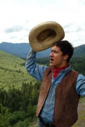 A cowboy yells,
