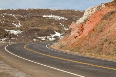 A hillside abuts the road.