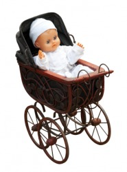 A baby doll in a toy pram.
