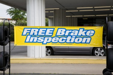 A banner announcing brake inspections at a tire shop.