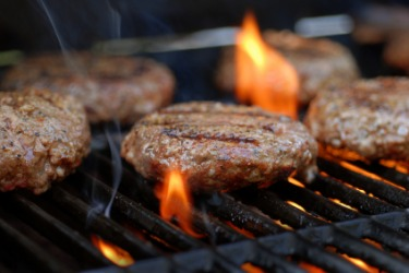 Barbequing hamburgers.