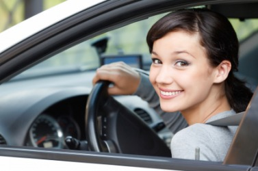 A young woman behind the wheel.