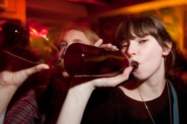 A woman binge drinking.
