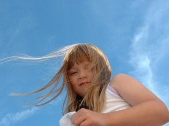 A girl's hair blows in the breeze.