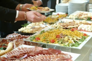 People serving themselves at a buffet.