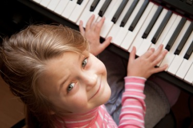 This little girl can play the piano.