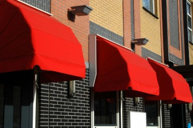 Windows with red canopys. & Canopy dictionary definition | canopy defined