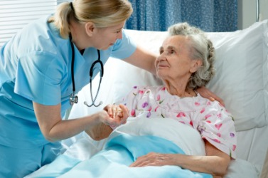 This nurse is acting as caretaker for her elderly patient.