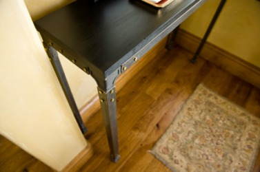 An example of a chamfer is a table corner.