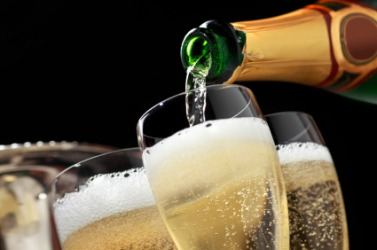 Pouring glasses of champers.