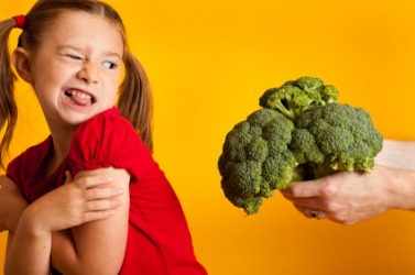 This girl detests broccoli.