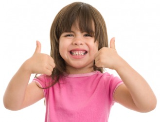 An eager child gives a double thumbs up.