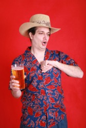A man belching after a drink of beer.