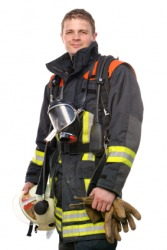 A man in firefighters garb.