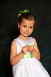 A little girl behaving in a very ladylike manner.