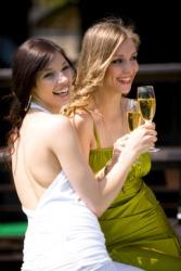 Two women lavishly dressed.