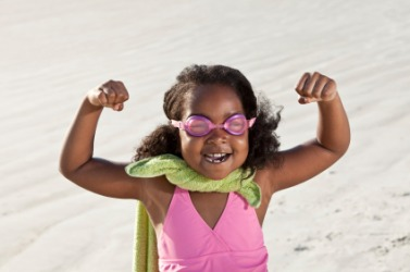 This little girl has made up a story about being a super hero.