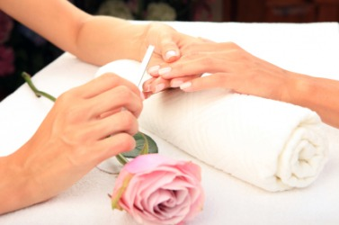A woman receiving a manicure.