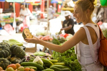 A Woman Shopping At A Farmers Market.