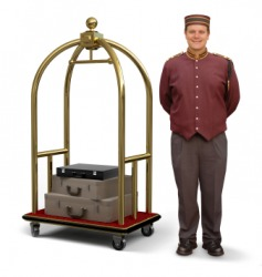 A bellboy, or bellhop, with a luggage cart.