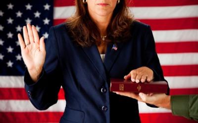 A woman swears an oath.