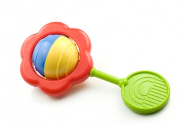 A child's toy rattle makes a rattling sound.