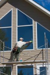 A window washer on a scaffold.