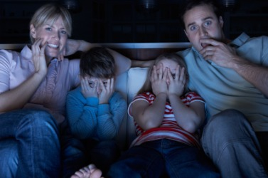 A family watching a scary movie.