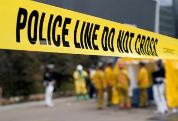 Police investigate a crime scene.
