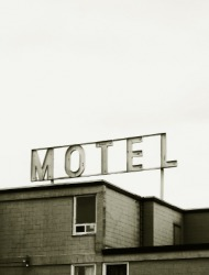 Sign over a seedy motel.