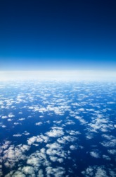 The earth as seen from the region of the upper atmosphere and space known as aerospace.