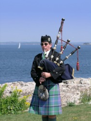 A man playing the bagpipes.