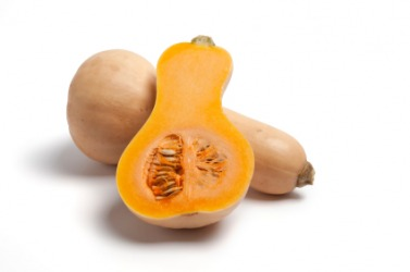 Butternut squash, one whole and one cut in half.