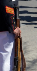 An honor guard holding a carbine.