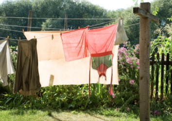 A clothesline supported by a wooden clothespole.