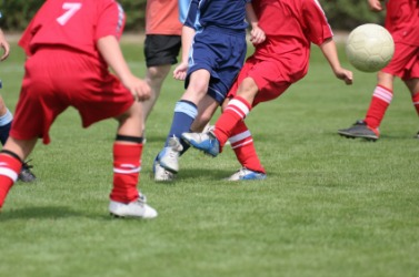 The footwork of a soccer game.