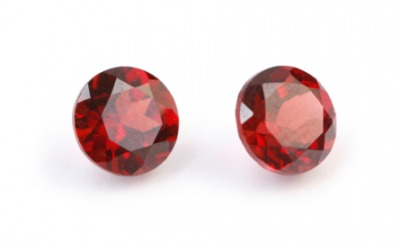 A pair of faceted garnets.