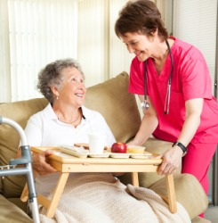 A woman receives in-home nursing care.