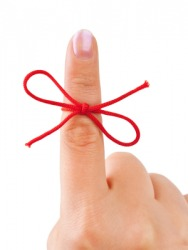 A red bow around the index finger.