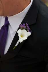 A man with a flower in his lapel.