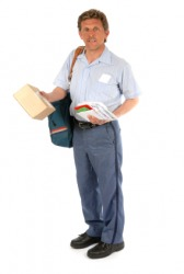A man carrying a mailbag.