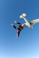 A parachutist jumps from an airplane.