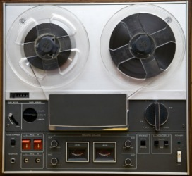 A vintage reel-to-reel tape player.