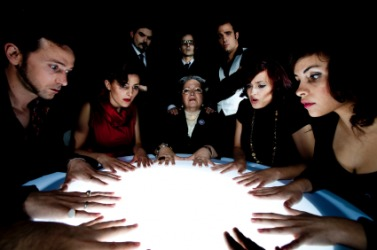 A group of people holding a seance.
