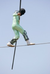 A man balancing on a tight rope.
