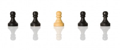The white pawn is betwixt the black.