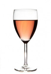 A glass of blush wine.