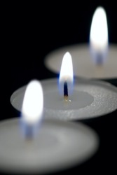Three burning candles.