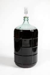 A carboy filled with fermenting wine.