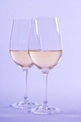 Two glasses of a white wine such as chenin blanc.